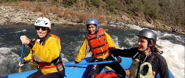 "Rafting guide trainees celebrate passage through ""Surprise,"" the last rapid in their run."