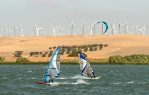 Windsurfers and a kiteboarder take advantage of a gusty morning at Sherman Island County Park on September 18, 2014.